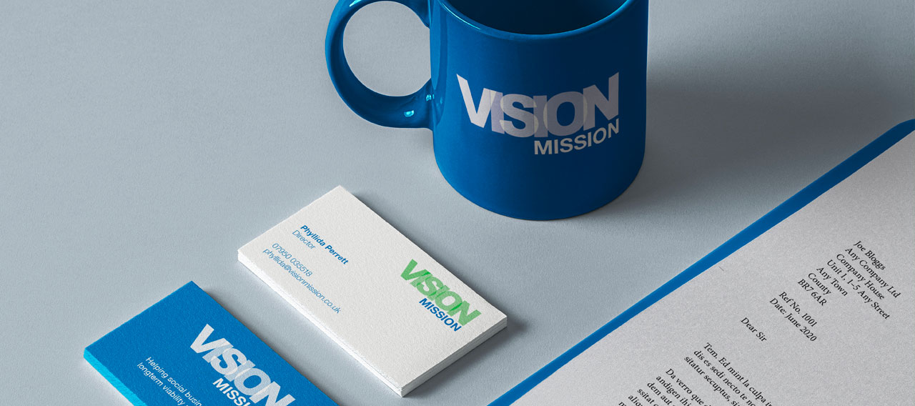Pic showing some Vision Mission business cards, letter and a branded mug